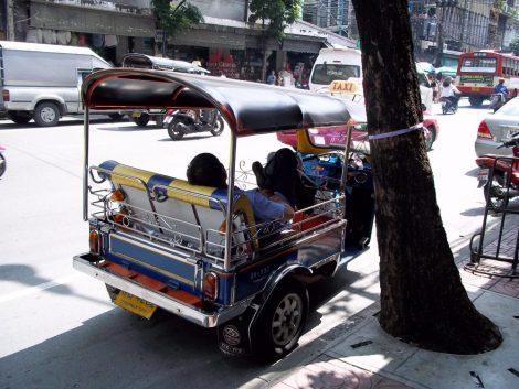 Tuk Tuk driver taking a break in Bangkok